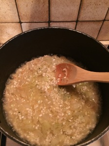 Adding the stock to the rice slowly