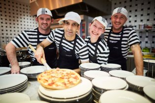 Pizza Express restaurant opens in the White Rose Shopping Centre in Leeds Yorkshire Pictured Pizzaiolos headed with Ehsan Nami make the first pizza (American)